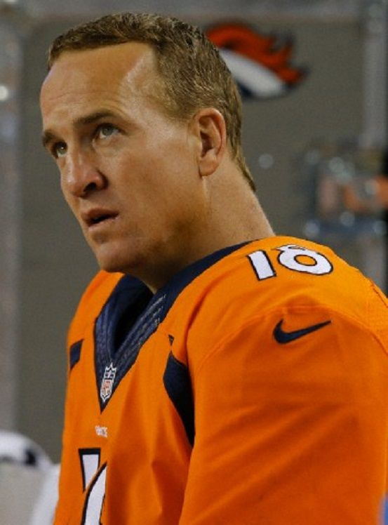 Denver Broncos quarterback Peyton Manning (18) sits on the bench during the…