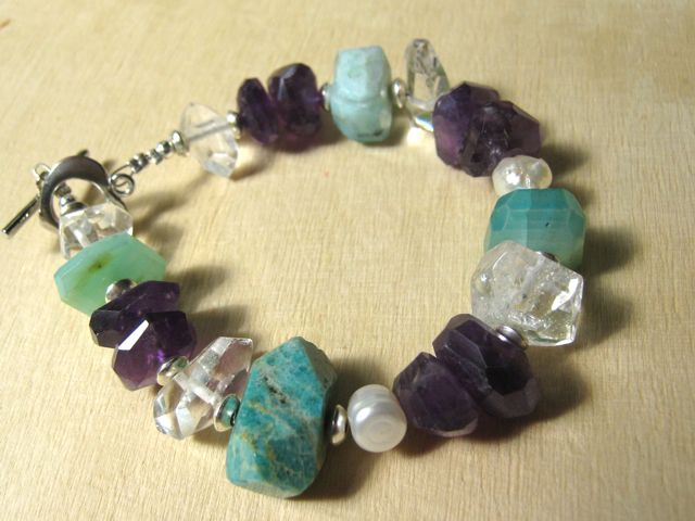 My latest bracelet - rough-cut amethysts, crystals, chrysoprase and a couple of baroque pearls. I don't make these for sale, just for fun and to wear. And sometimes for friends.