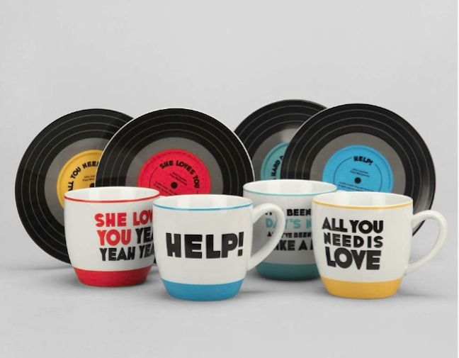 A set of 4 cups each decorated with some of The Beatles' top hits. On the front, you'll find the title of the song and few lines of the lyrics at the back. And to complete the cool musical theme, each cup comes with its own saucer designed to look like a vinyl record. I MUST HAVE THESE
