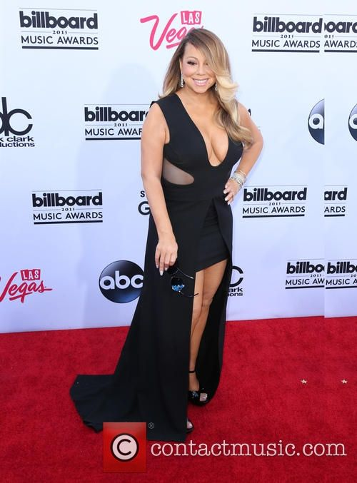 Mariah Carey looked gorgeous at the 2015 billboard music awards wearing this low cut, Tom Ford, black dress