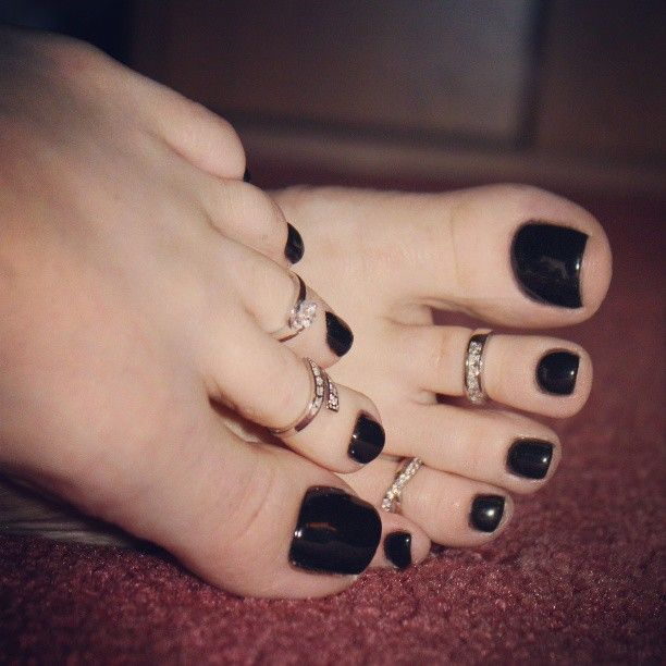 I ALWAYS wear black polish on my toes. If not black, any dark shade: navy, red wine color... Love the toes rings too