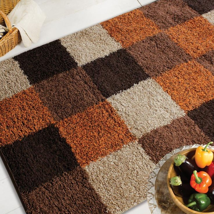 These Gy Rugs With A Block Design In Contrasting Shades Of Brown And Orange Are Easy