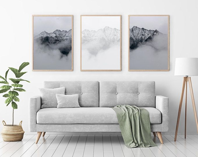 The Focal Point Is The Center Piece Of Artwork Because Of The Contrast Of The Ones Next To It In 2020 Living Room Scandinavian Home Living Room Minimalist Living Room #prints #for #the #living #room