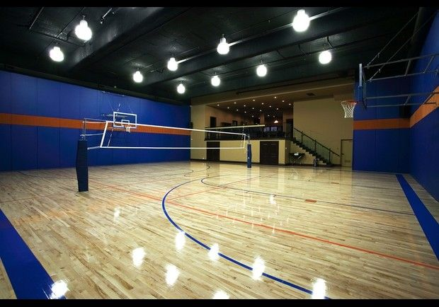 This is an Indoor Basketball Court home in Summerlin, Nevada.  It has the same flooring and material beneath it as you find on a professional basketball court.  It is about 3/4 the size of a full court, it comes equipped side posts for a volleyball net and a game viewing area with leather seating behind an adjacent glass wall.