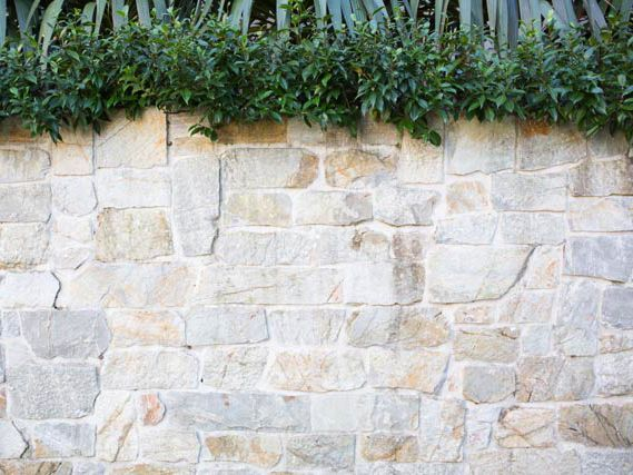 Close view of Eco Outdoor Coolum random ashlar limestone walling. Entrenched Landscapes | Eco Outdoor |…