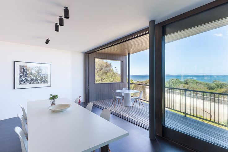 Located in Somers about an hour from Melbourne, Residence J&C is a holiday beach house designed by Open Studio Pty Ltd Architecture with views of the bay.