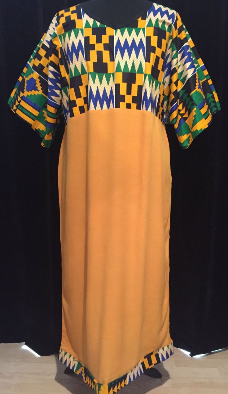 Large V Neck Sunflower Kaftan with traditional Ghanaian Kente African print by ChicNtoma on Etsy https://www.etsy.com/uk/listing/398075957/large-v-neck-sunflower-kaftan-with