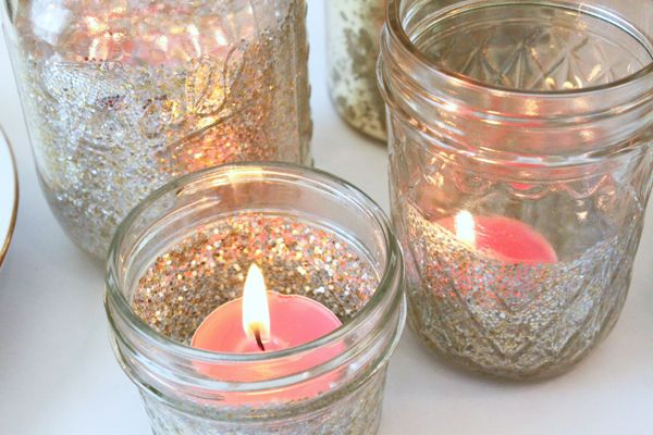 Small Mason Jars with tea lights  glitter.