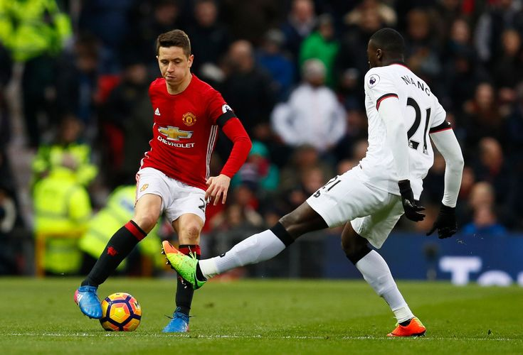 Ander Herrera in action with M'Baye Niang