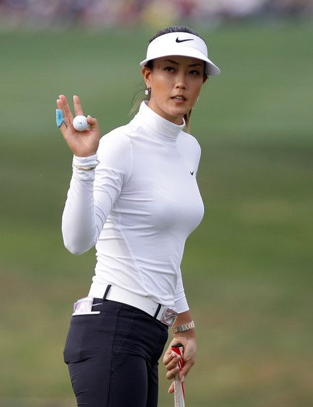 Michelle Wie Photos Photos - Michelle Wie of United States reacts after a putt on the 18th hole during day four of the KEB Hana Bank Championship at Sky 72 Golf Course on October 19, 2014 in Incheon, South Korea. - KEB Hana Bank Championship - Day 4