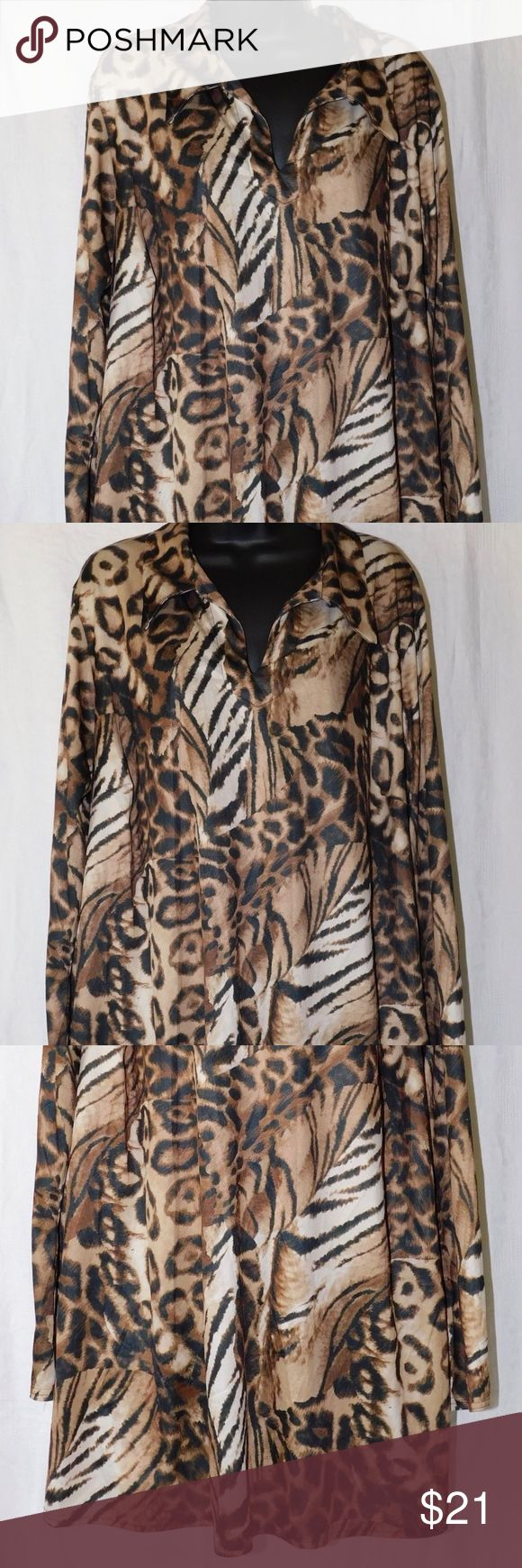 """Resource Animal Print Long Sleeve Tunic Top Resource Animal Print Long Sleeve Women's Slip-On Blouse Tunic Top  Details: Plus Size: 22-24 Long Sleeves Collar no button slip on style Vent slits at the hemline Approximate Measurements taken laying flat: 26"""" Armpit to armpit 34"""" Length from shoulder to hem 24"""" Sleeve length from shoulder to hem 100% polyester; Machine wash  In very good pre-owned condition   From a Smoke Free/Pet Free Home Resource Tops Tunics"""