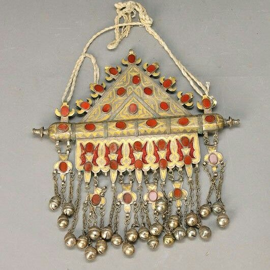 Large amulet Tumar, antique 19.th c., Turkestan, metal with gold damascene ornamentation, Triangulum with red cabochon- trimming of chalzedon, cylindric amulet case for giving personal items protection, ethnological object, 32 x 32 cm Photo and Text : Live Auctioneers  Sold by Live Auctioneers