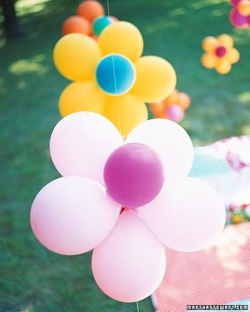 Flower Power Party - Bouncy and bright! Balloons and flowers are the theme for this backyard birthday party.