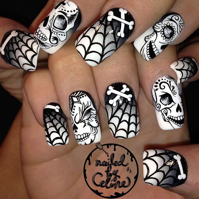 Ghoulish greyscale gradient nails complete with spooky sugar skulls and spiderwebs for the one and only @angelinagalvis_  #nailedbyceline #nailart