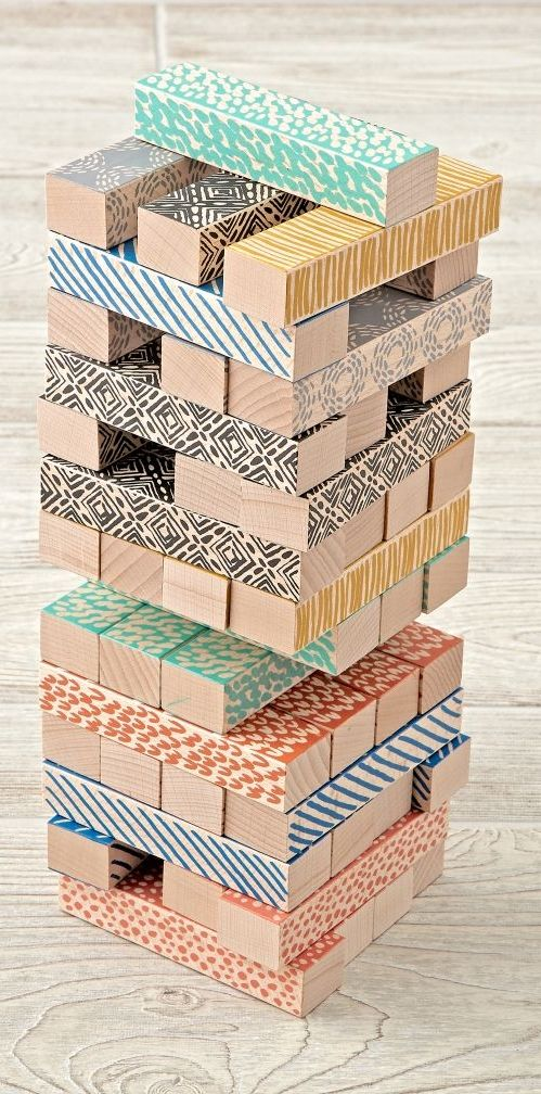 This classic wooden game features colorful designs created exclusively for us by Kelly Ventura. Stack the blocks one by one to form a tower. Next, take turns removing blocks to build an even taller tower. Don't let the tower fall!