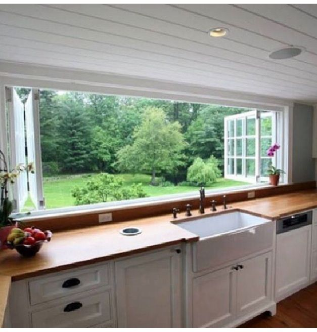 Dream kitchen. Love how the windows open but I think that I would want some sort of screen over it to keep the bugs out.