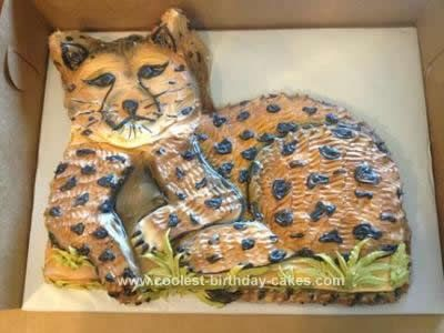 Homemade Cheetah Birthday Cake: This Cheetah birthday cake was cut out of a half-sheet cake. To get the shape I used a small piercing knife to cut the basic outline of the cat out. Next