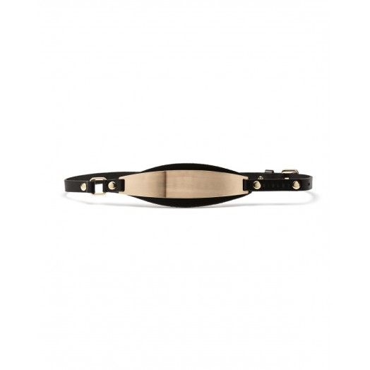 Cintura, punto vita in pelle, con maxi placca in metallo. Altezza fusto 1,5 cm.