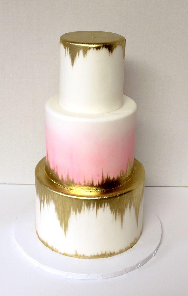 Gold metallic semi-drip cake with watercolor #weddingcake #urbanicing #gold…