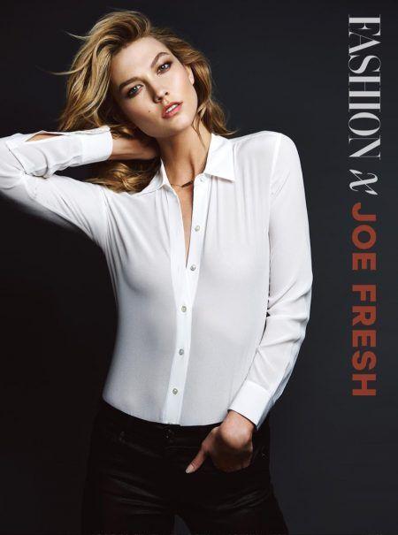 Karlie Kloss wears white shirt and black pants