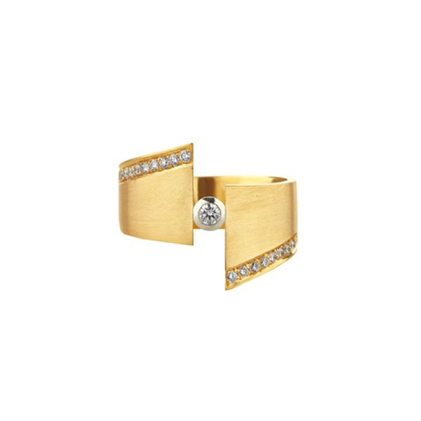 """Angular and contemporary, the gold Eclipse ring really holds its own! Made to size in our in-house workshop, the round brilliant cut centre diamond is flanked by smaller pave set diamonds and the matte finish 9ct gold makes the diamonds really pop – for those who dare!Approximately 17mm wide.<a href=""""http://www.stonechatjewellers.ie/product-category/ann-chapman-eclipse"""">View the full Eclipse collection</a>"""