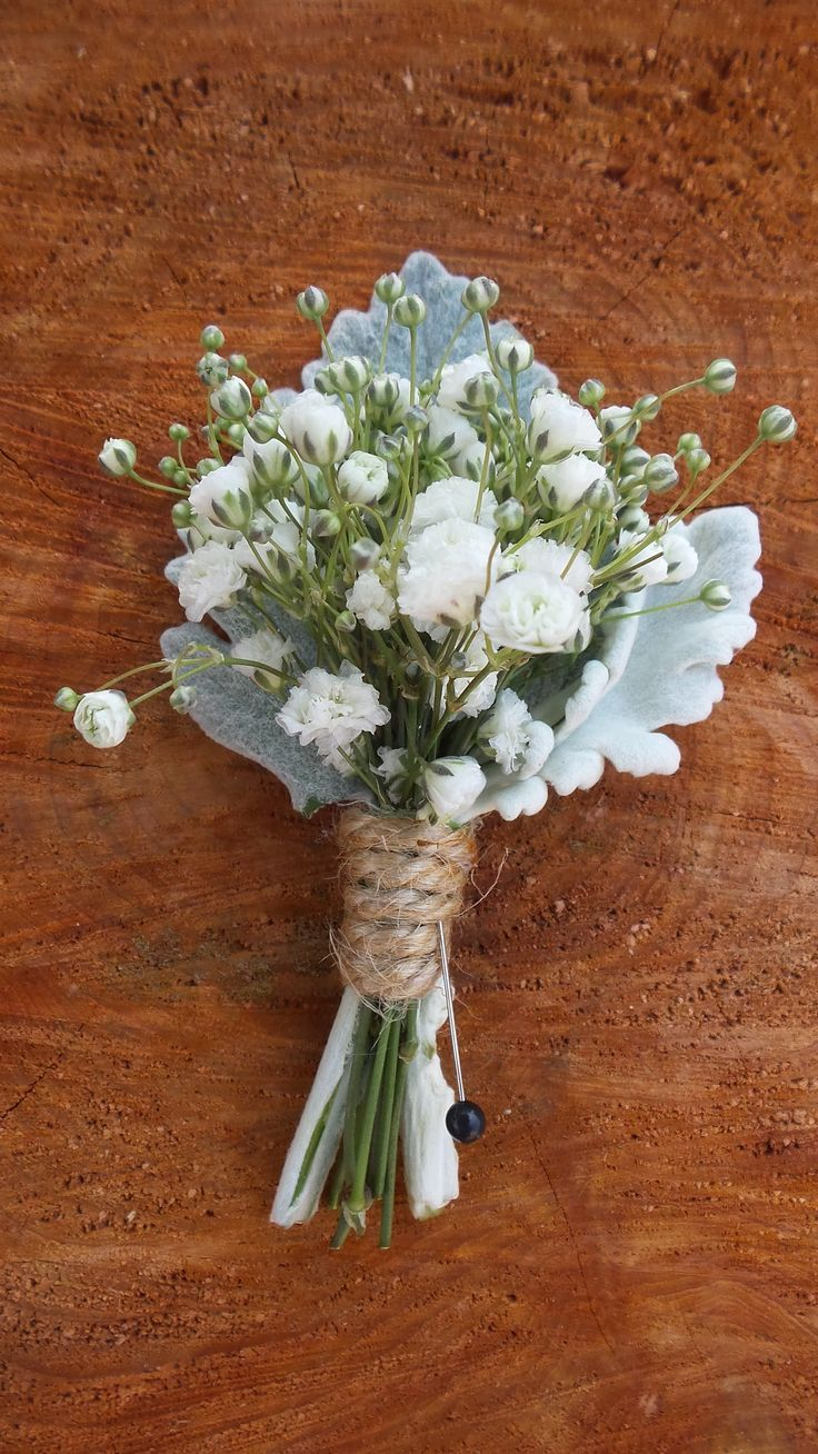 Babys Breath Boutonniere with Dusty Miller, Wrapped in Twine.