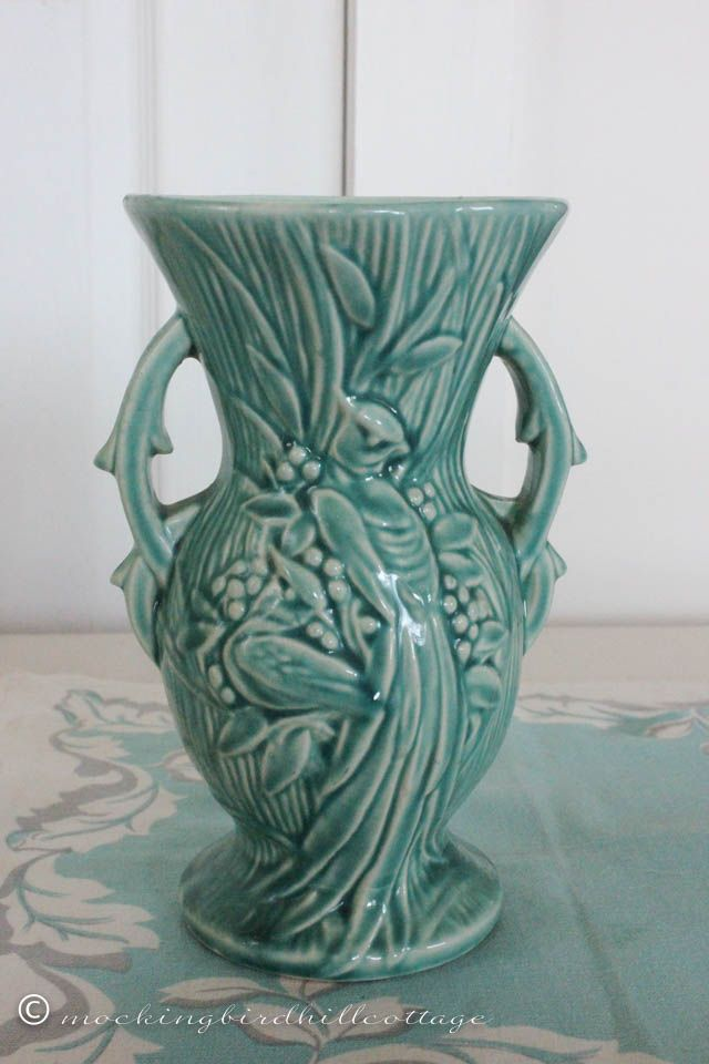 PEACOCK VASE : Simply gorgeous! The beautiful peacock is on both sides. Manufactured by McCoy, 1948.