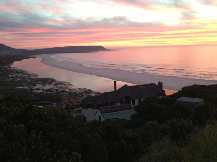 View from Chapmans Peak Drive over Crowned Eagle Lodge at Monkey Valley Resort Noordhoek, Cape Town