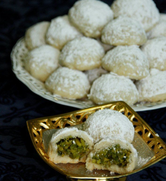 Ma'amoul are delicate little stuffed pastries that are served all over the Arab world for Eid and Easter. They have several fillings—dates, walnuts or pistachios—and they come in a variety of shapes. Sometimes they are made with semolina, sometimes flour. (sounds yummy)