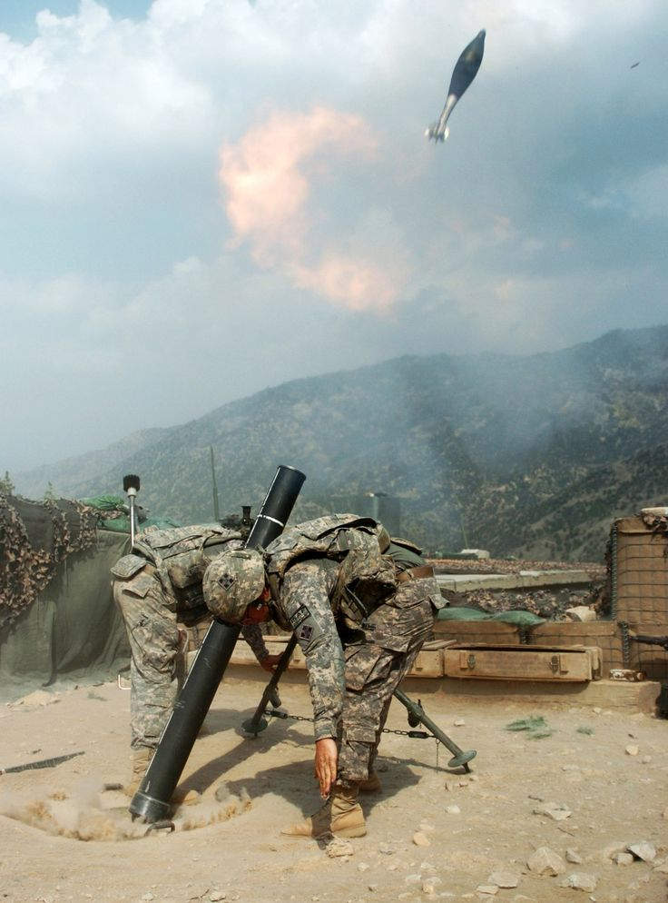 US Army mortar team fire on Taliban positions with a 120 mm mortar