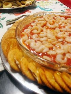 Easy Cream Cheese Shrimp Dip   1 pkg cream cheese, softened  1 bottle cocktail sauce  1-2 cans baby shrimp  Soften cream cheese and spread out onto pie plate. Pour cocktail sauce over cream cheese, top with shrimp. Cover with plastic wrap and refrigerate till ready to serve. Tastes best with Ritz, Wheat Thins or Triscuits.
