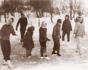 Winter ice skating. Fun outdoors no sitting at a computer. Kids had nice rosy cheeks back then.