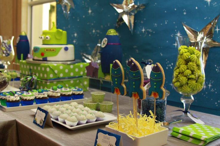 Rocket cookies cupcakes...green blue, rockets, stars, planets, green macaroos,buzz cake