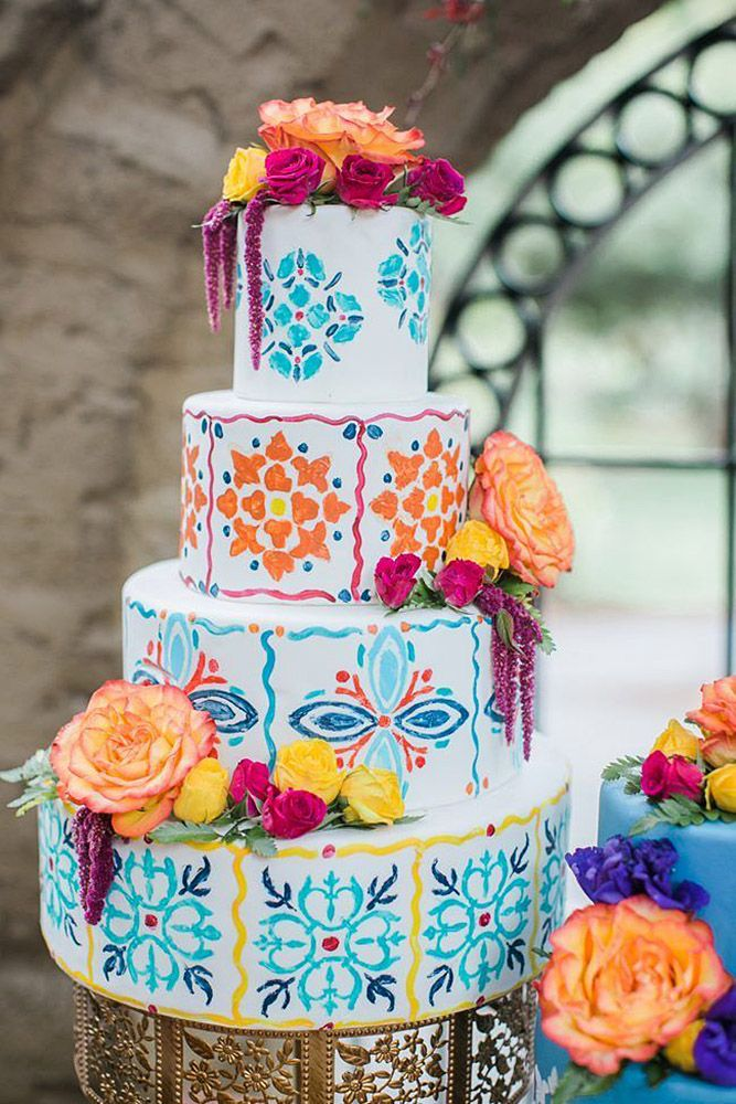 mexican wedding cake with mexican ornaments decorated with fresh roses sweet blooms photography
