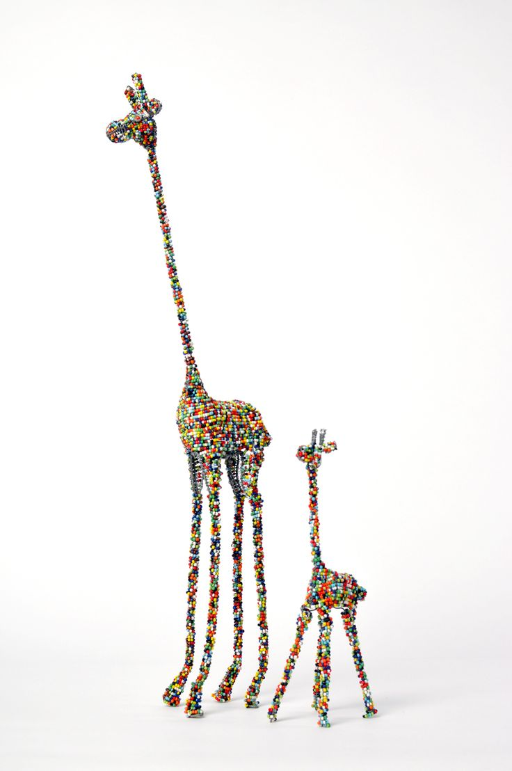 Small and medium multi-coloured giraffes