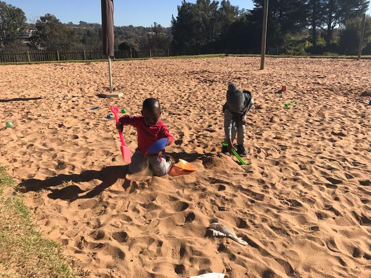 At the Fields Montessori in the park . Sandplay