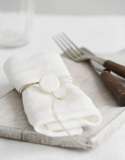 beach - white linen napkins wrapped with twine & sand dollars