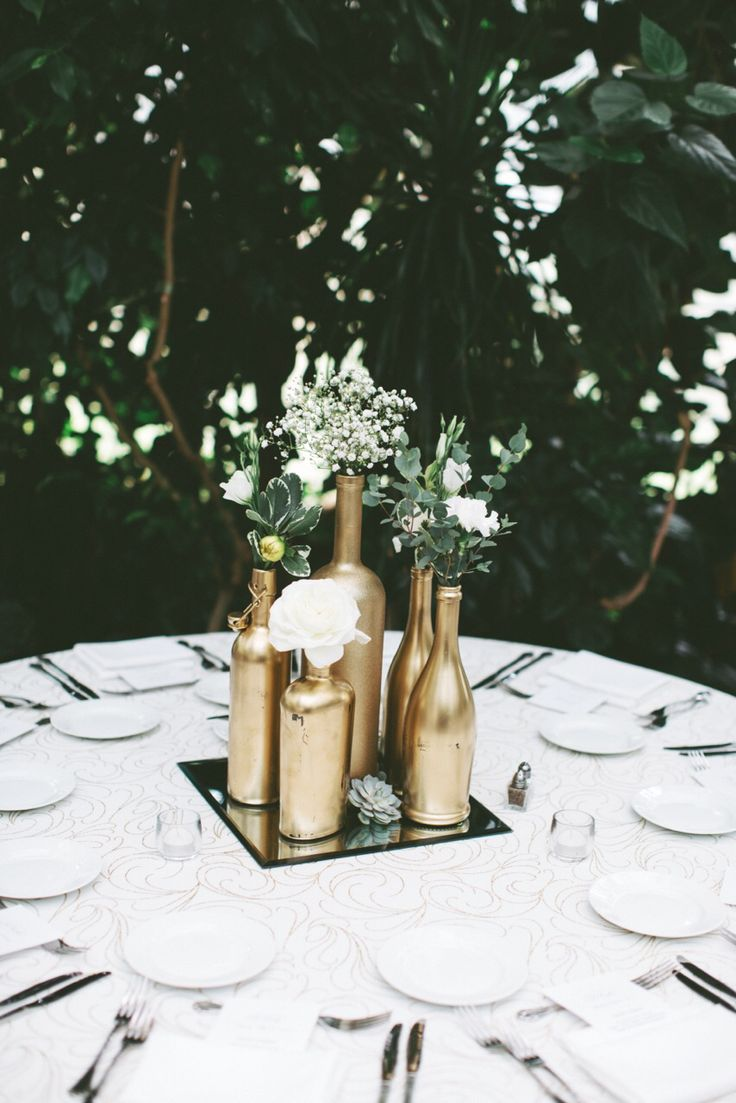 Gold centerpiece. Gold spray painted bottles. Wedding centerpiece. Greenhouse wedding. La caille wedding. DIY.