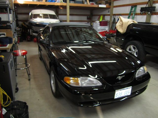 make ford model mustang year 1996 body style convertible exterior color black interior. Black Bedroom Furniture Sets. Home Design Ideas