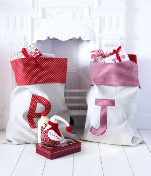 Personalized Christmas sacks... okay, so I'm pretty sure even I could sew these... now that the kids are older, and our space is more limited, how neat to give them a sack of gifts instead of having them spread all over???
