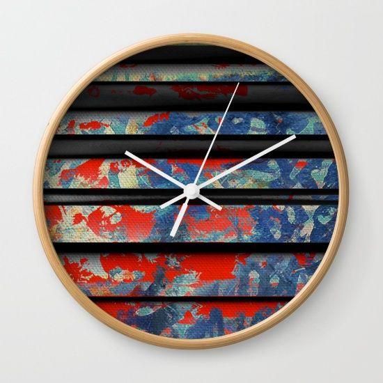 Blue Wall by Fernando Vieira, $30. https://society6.com/product/blue-wall-seg_wall-clock?curator=bestreeartdesigns