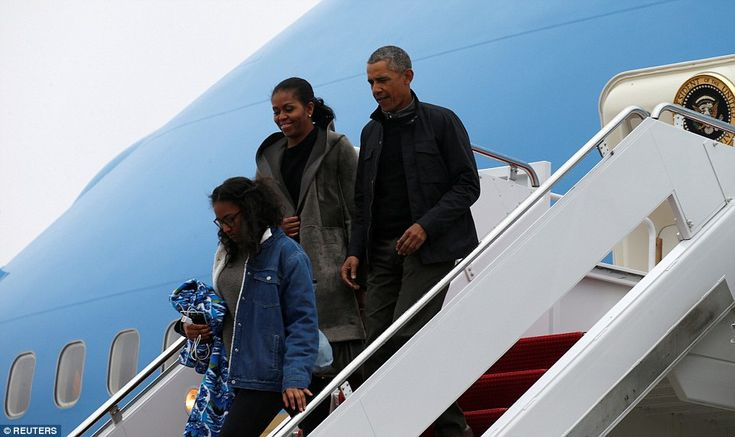 Malia was dressed down for the chilly weather in a fleece-lined denim jacket and a gray sw...