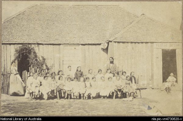 Teachers with group of schoolgirls seated outside the Public School, a slab building with shingle roof, Tambaroora, New South Wales, ca.1872 [picture].  1872 or 1873. 1 photograph : sepia toned ; 6 x 9.4 cm.    From National Library of Australia collection  http://nla.gov.au/nla.pic-vn4730820  nla.pic-vn4730820