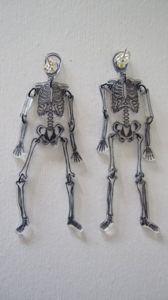 These lovely shrink plastic dangle skeleton earrings are hand drawn with silver plated earring backs. by Mgthreads