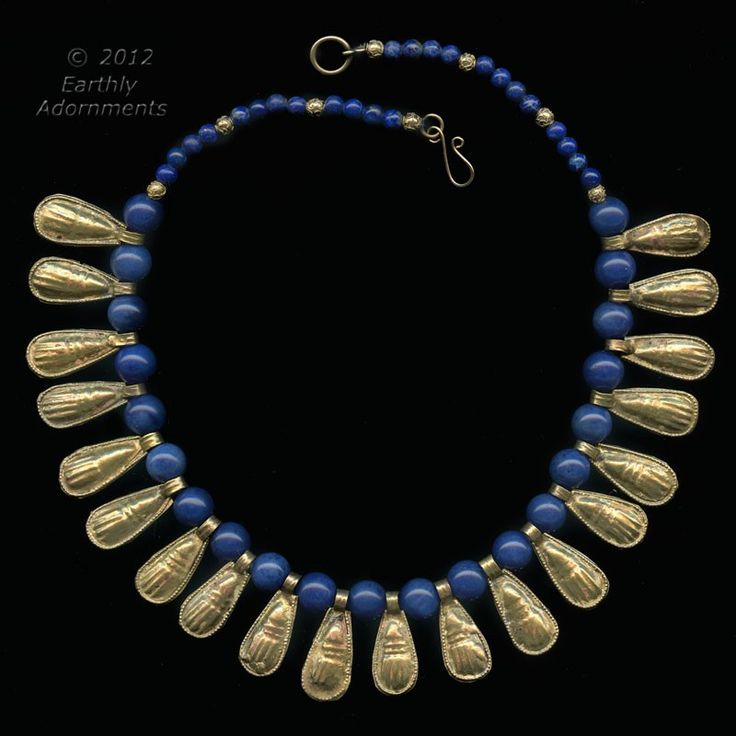 Old stock Lapis Lazuli beads with Ethiopian gold-washed scarab shape pendants in ancient Egyptian style.  Finished with small silver vermeil beads.  A copy of an ancient Egyptian necklace.
