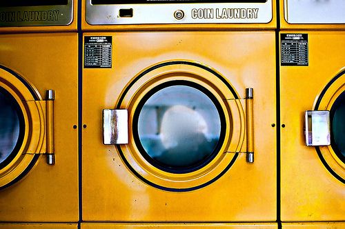 Pour a bit of vinegar into the wash with your detergent - it eliminates odors and brightens colors.