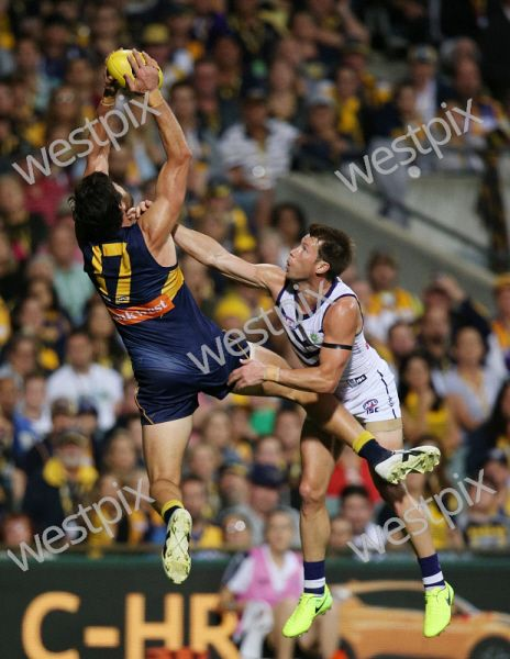 AFL Round 6 - West Coast Eagles v Fremantle Dockers at Subiaco Oval, Perth. Pictured - Eagle Josh Kennedy out marks Fremantle's Lee Spurr  Picture: Daniel Wilkins
