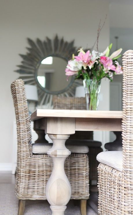 Lovely Dining Rom With Pine Table Balustrade Legs Wicker Chairs And Gray Driftwood Mirror