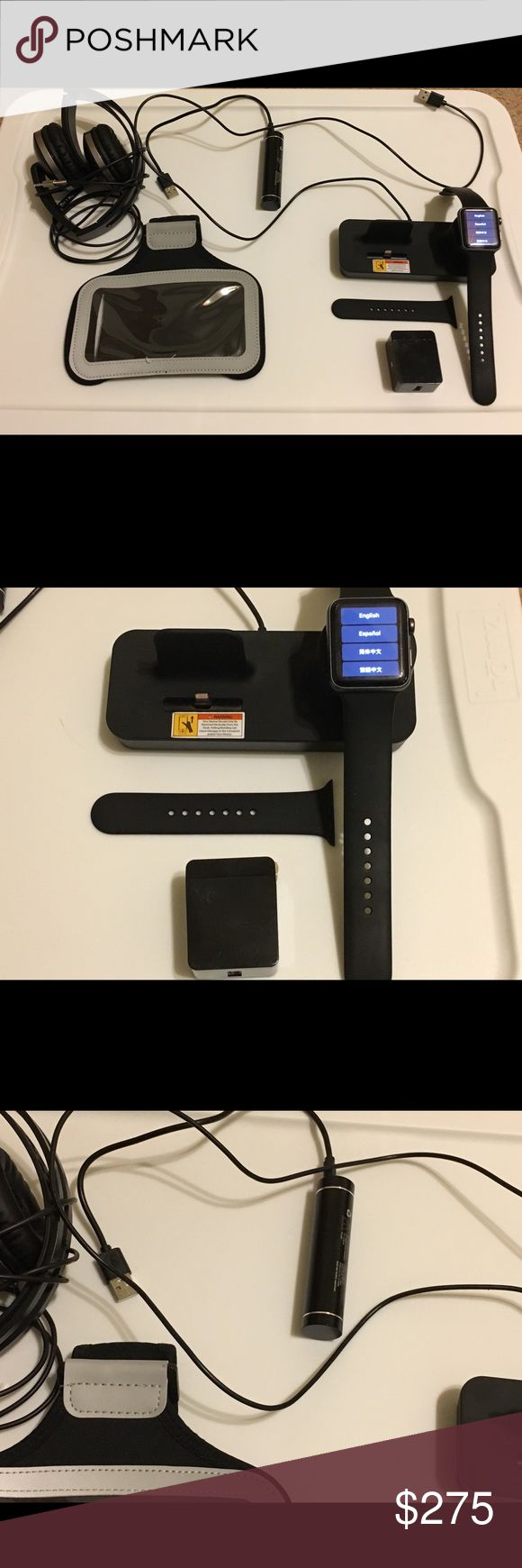 Apple Watch Series 2 42mm Aluminum Case Apple Watch Series 2 42mm Aluminum Case Black Sport Band - (MP062LL/A) Includes charging deck, portable charger, extra band, headphones and an armband case. Apple Accessories Watches