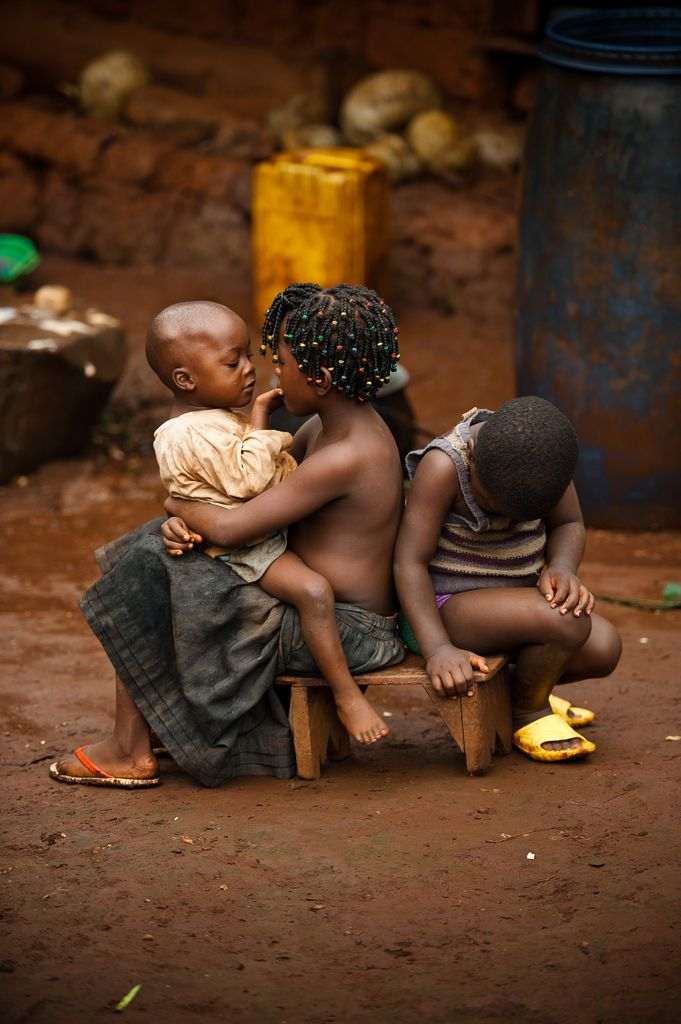 Children keep each other company outside their home in Cameroon, Africa, 2011.